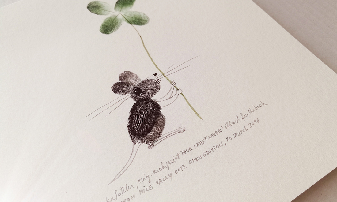 Mouse with a four leaf clover